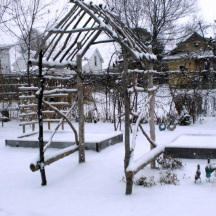 The rustic arbor is my most complex structure so far. Here it stands through Winter 2010.