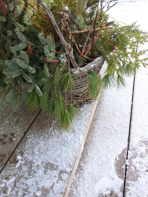 A rustic basket on the back porch steps.